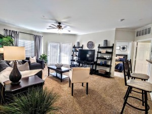 One Bedroom Apartments in San Antonio, TX - Model Living Room, Breakfast Bar and view of the Bedroom